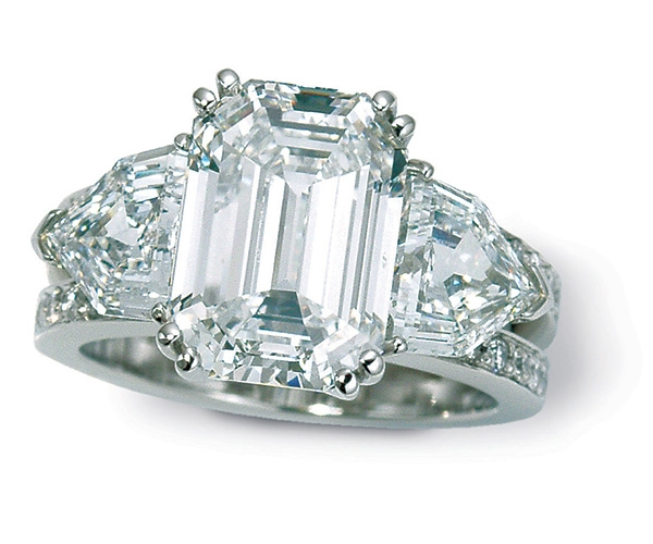 Emerald Cut Center with Shield Cut Sides and Round Brilliant Band